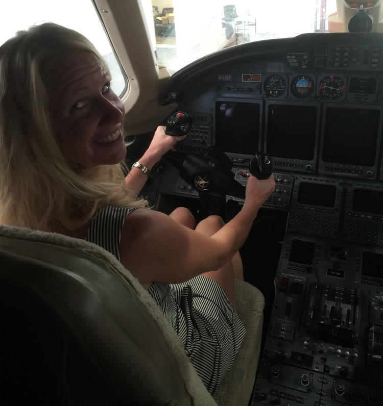 woman steering plane